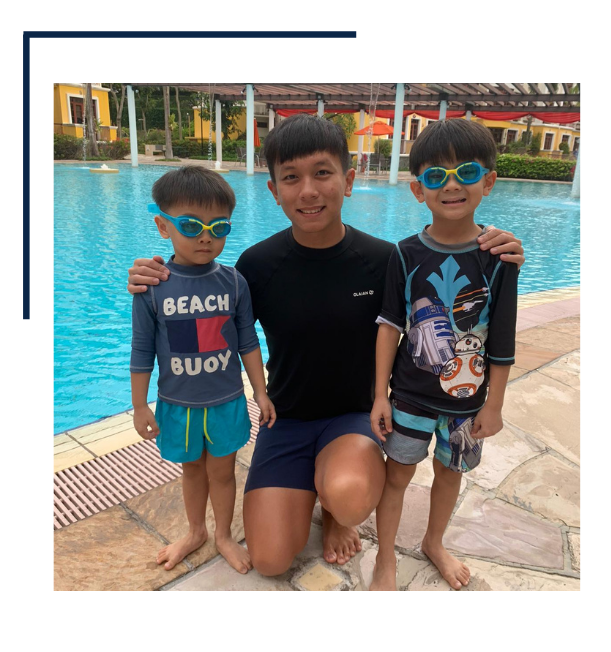 Male Swimming Instructor With His Students