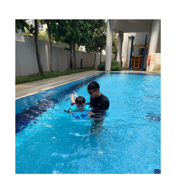 Male Swimming Instructor With Young Student